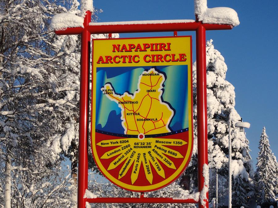 arctic circle sign in rovaniemi in finnish lapland hotel aakenus
